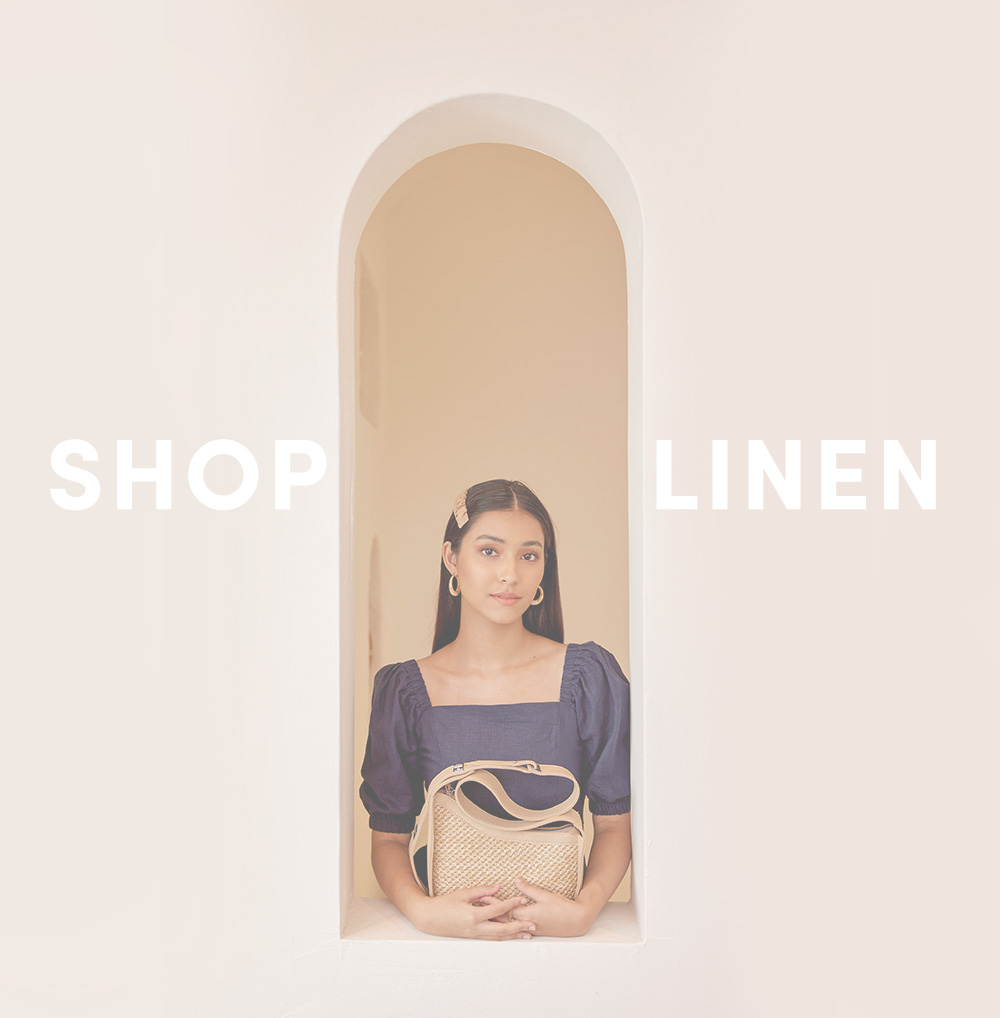 shop linen at her velvet vase